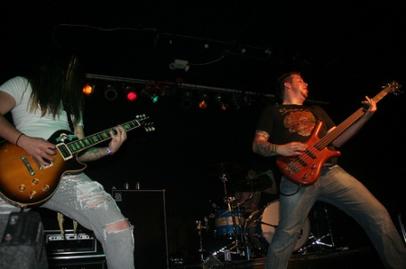 Marshall (right) striking a rock pose at Playing With Matches' farewell show in May