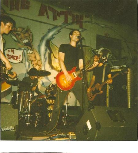 The Way We Were: Fern playing The Attic in the mid-90s. Note the wall mural with the intentionally misspelled name.